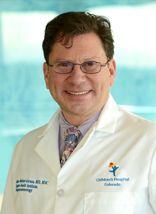 A profile photo of Dr. Belkind-Gerson wearing his Children's Colorado lab coat.