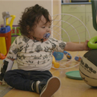 Patient Manolo Gonzales plays with a ball