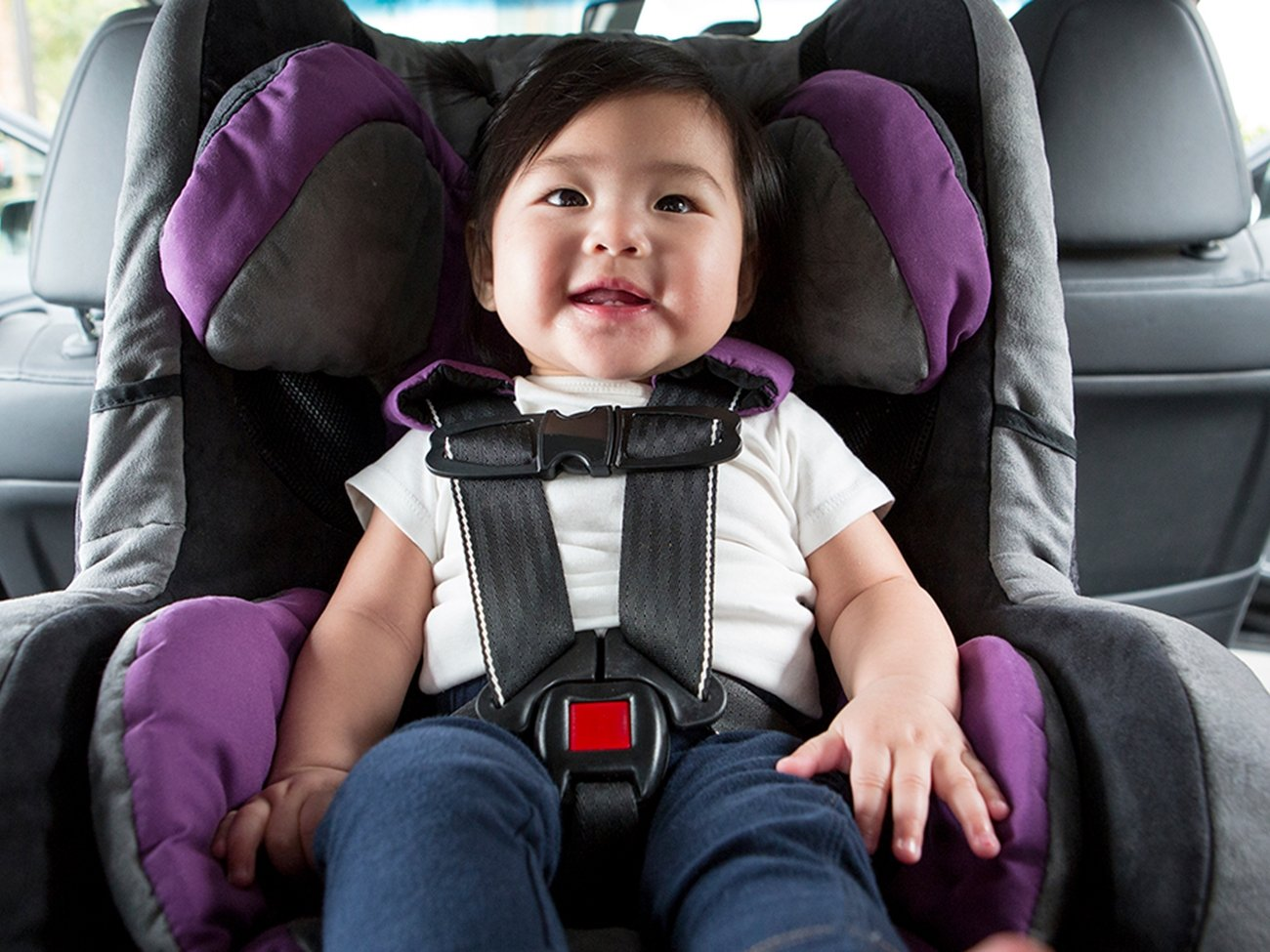 A Baby Sits In Purple Car Seat Rear Facing Inside Of With