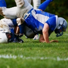 A football player crashes to the ground on his AC joint.