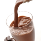 Pouring a glass of chocolate milk for sports recovery nutrition.