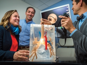 Dr Emily DeBoer, along with two other physicians practice a bronchoscopy procedure on 3D-printed lungs.
