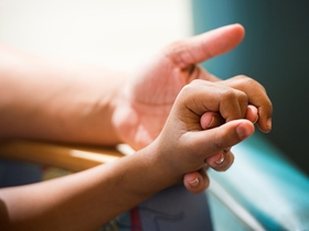 A parent holds a child's hand as part of a research study about age, cancer diagnosis and survival rates.