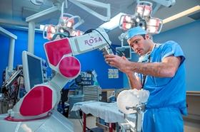 Dr. Brent O'Neill uses ROSA the Robot.