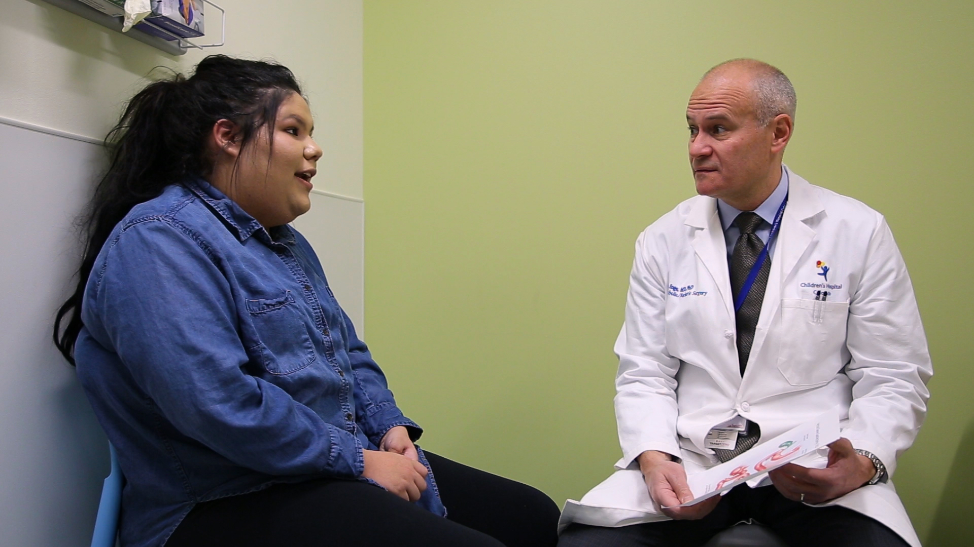 Dr. Thomas Inge is in the bariatric surgery clinic speaking to an adolescent patient.
